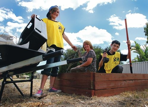 Community gardeners Chelsea Schokker, Dawn Burns and