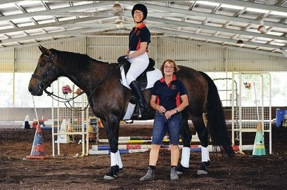 Claremont Therapeutic Riding Centre founder M'liss Henry with dressage competitor Sara Cann on her ride Choco, who has been with the centre for 35 years. Picture: Marcus Whisson www.communitypix.com.au d395602