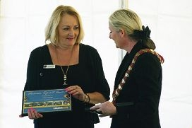 Julia Hodge accepts her Human Spirit Award from Mayor Tracey Roberts.