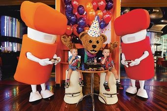 Princess Margaret Hospital Foundation mascot Stitches celebrates his eighth birthday with twins Andrew (3) and Michael Mitchell (3) and iiNet mascots Ian and Irene.
