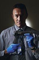 Detective senior constable Karl McLeod with the replica gun.
