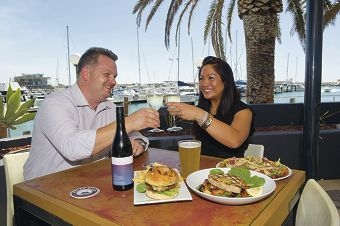 Mindarie Marina general manager Mark Jones enjoying a glass of wine with staff