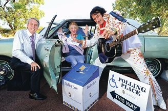 Western Australian Electoral Commissioner Warwick Gately with drive-in voter Dot Wylie (89) and Elvis (aka Steve Bunbak). Picture: Marcus Whisson www.communitypix.com.au d396779