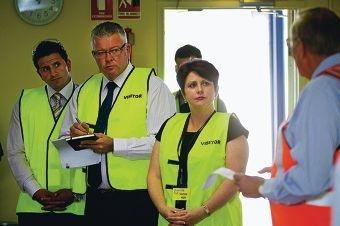 Daniel Parasiliti, Troy Buswell and Alyssa Hayden talk to truck drivers about the Lloyd Street extension. Picture: Matthew Poon www.communitypix.com.au d396667