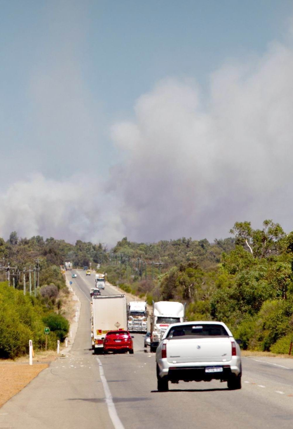 Billowing smoke above north-bound traffic on Great Northern Highway last Thursday.
