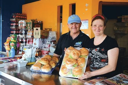 Rous Head Cafe owner Geoff Fletcher and his daughter Cassy with burgers made for the film.