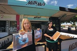 Milk Mo's owner Angie Baldrick holds up pictures of the missing Waffly while daughter Gemma Wilson holds up the reward: a five-litre tub of chocolate |ice-cream. Picture: Elle Borgward www.communitypix.com.au d396936