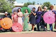 Ishar Multicultural Women's Health Centre staff dressed to impress at their International Women's Day event.