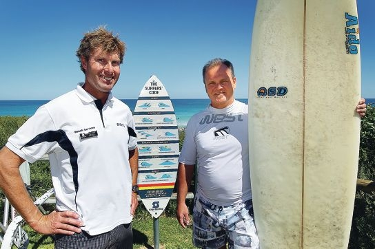 Beach services co-ordinator John Snook and Cr Jason Robbins with the new surf rules sign. Picture: Dominique Menegaldo d397171