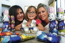 Nicolette Mullan (right) with daughters Nicole (16) and Alexea (6), and some collected Easter treats. Picture: Dominique Menegaldo d397265