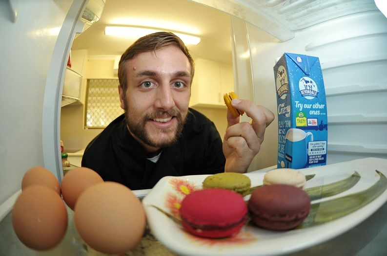 Pastry chef Mitch Strickland savouring his own macarons.