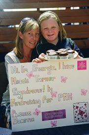 Justine Snowdon with her daughter Georgia, recently diagnosed with Mosaic Turner Syndrome, selling cupcakes to raise money for PMH.