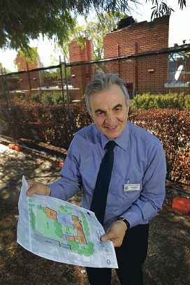 Mt Lawley Primary School principal Don Barba with plans for the school rebuilding project. Picture: Andrew Ritchie d397237