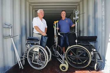 Australian Doctors for Africa volunteer Robert Forward and Apex Perth branch treasurer David Wartzki load a shipping container with medical |supplies for Ethiopia. Picture: Marcus Whisson d397568