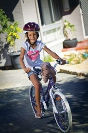 Lexi Oliver is enjoying a normal childhood after three rounds of heart surgery, out for a ride on her new bike, donated by Heartkids WA. d397082