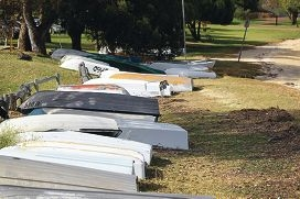 Dinghies lined up along the Bicton foreshore.