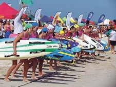 On your marks: board surfers get ready to take to the water.
