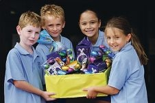 Our Lady of Fatima primary students Cooper Forzatti,Xavier Houston,Erin Peters and Lucy Welch with Easter eggs collected for children at the refuge. Picture: Martin Kennealey d397731