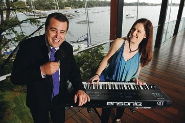 New Redkite president Alan Pavisich with keyboardist Alexa Miller. Picture: Marcus Whisson www.communitypix.com.au d397299