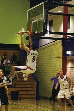 Jarrod Balcombe makes a high-flying dunk.