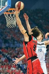 Matthew Knight defends against New Zealand Breakers player Thomas Abercrombie. Picture: Tasha Hutchinson/Perth Wildcats