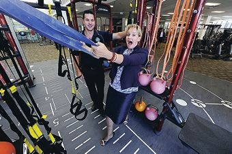 Beatty Park Leisure Centre manager Dale Morrissy with City of Vincent Mayor Alannah MacTiernan, who is trying out on of the new fitness aids.