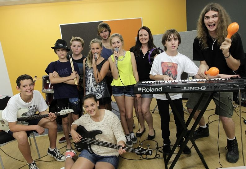 Sam Touchell (director of the Rock Academy) and Grant Touchell (teacher  from the Rock Academy) and students.