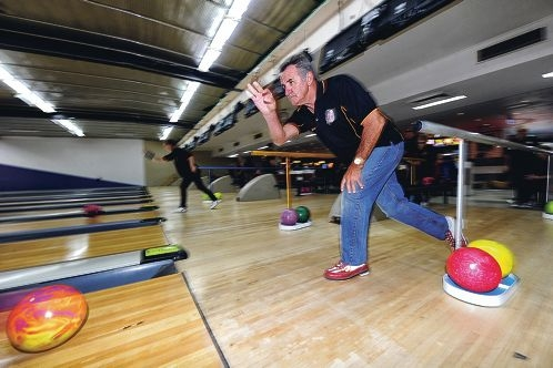 Legally blind tenpin bowler Bob Fleming in action [NAME OK]