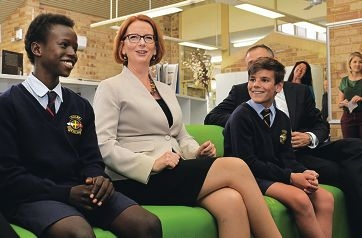 Year 8 students Amin Longolio and Harrison Johnston with Prime Minister Julia Gillard.
