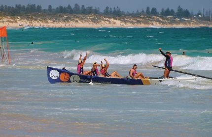 Mullaloo Barracudas cross the finish line and celebrating their open men's surf boat gold medal.