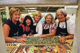 Anne Gilmour, Lesley Knox, Anita Newman, Kate Wood and Merrilyn Langford with some of the mosaics that will be installed at McDougall Park. Picture: Matthew Poon d397803
