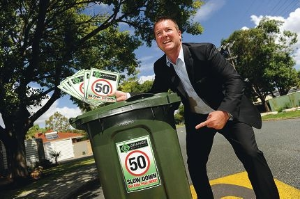 Paul Brookes with his bin stickers.