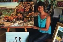 Artist Gilly Huber with her works. Picture: Bruce Hunt www.communitypix.com.au d398688