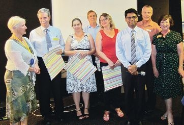 Rotarians at a microscope presentation ceremony.