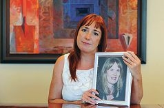 Debbi Greenwood with a photograph of her late friend Jacqui Gribben.