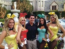 Hems Thakrar with four Playboy Bunnies at the Playboy Mansion, Los Angeles.
