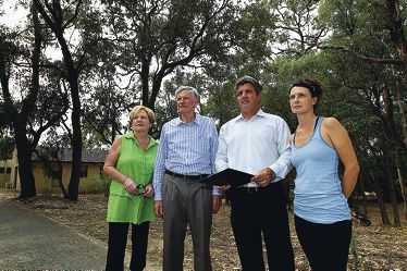 Faye Dhue, Paul Druitt and Mike and Chrissy Kneebone at the site of the proposed fivestorey retirement complex. Picture: Dominique Menegaldo www.communitypix.com.au d399109