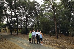 Local residents Faye Dhue, Paul Druitt and Mike and Chrissy Kneebone at the site of the proposed retirement complex.