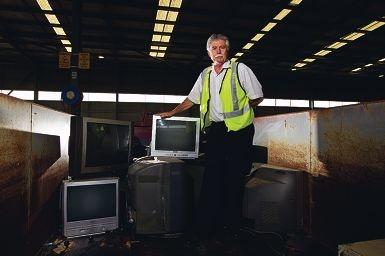 Bernie Burnett with some of the dumped TVs. www.communitypix.com.au d399422