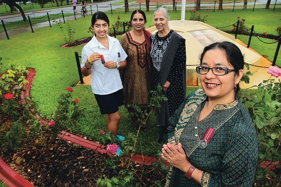 From left: Husveena Singh with her grandfather's medal,Harneet Kaur, Husveena's grandmother Kuldeep Jassal and Kuldeep's daughter Kuljit Singh. d399119