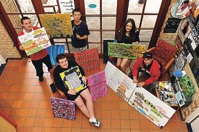 Drug and Alcohol Youth Service clients Kieran, Samuel (sitting),|Maverick, Jordann and Daniel with their artwork.