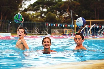 Ben (10) and Matt Colliss (12) with their mother Sharan, who has notched up more than a 1000 games of water polo. Picture: Andrew Ritchie www.communitypix.com.au d399025