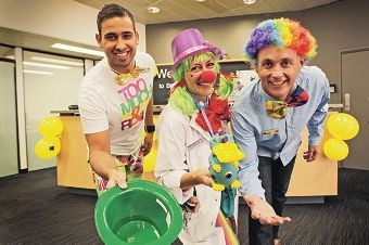 Brendan Ross, Raelle Peacock and Paul Armstrong from Belmont Commonwealth Bank in full costume to raise money for the Clown Doctors.