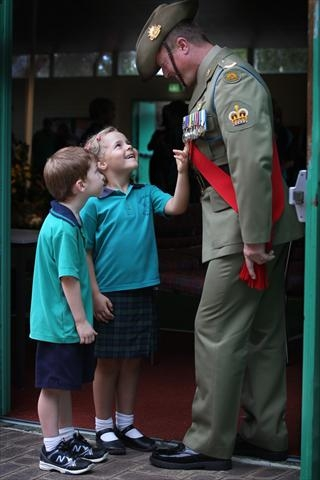 Year 1 students Beau van der Beeke and Abby Letts with Warrant Officer Nigel Bennett . Picture: Bruce Hunt www.communitypix.com.au d399507