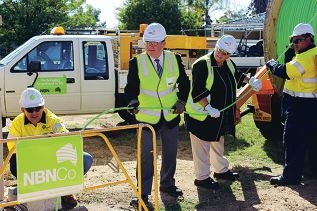 Wiretel Network Solutions workers help Brand MHR Gary Gray and Mandurah Mayor Paddi Creevey haul the first NBN fibre in Mandurah.
