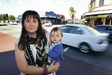 Jo McElvenny with her son Hamish at the dangerous intersection. Picture: Dominique Menegaldo d399894
