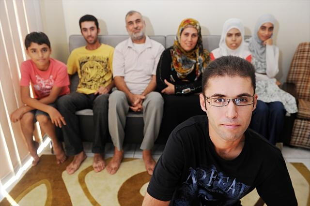 Karrar Albaheli (foreground, 24) a refugee from Basra, Iraq, with his family, from left, brothers Montadher (11) and Zolfeqar (19), father Qotaiba, mother Nawahedh and sisters Raghda (18) and Waqar (22).