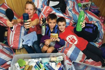 Oliver Frost, Vincent Pettinicchio and Jarrad Capolingua have made up care packages to help the homeless.
