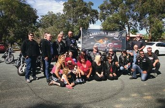 Tracey and Riley McKechnie with club members from FBDC, Karratha Bikers Lower 26th Chapter and SRSC. Picture: Robin Kornet www.communitypix.com.au d398665