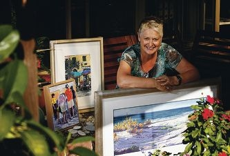 Artist Val Brooks at home with her paintings, some of which will be on sale this weekend. Picture: Marie Nirme www.communitypix.com.au d399895